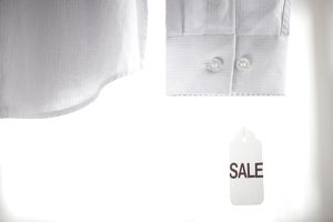 sale tag on shirt sleeve