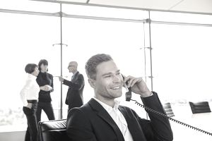 Smiling businessman phoning in conferenceroom