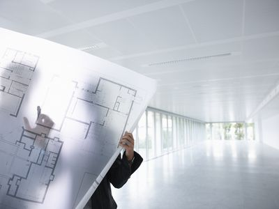 Architects looking at blue prints