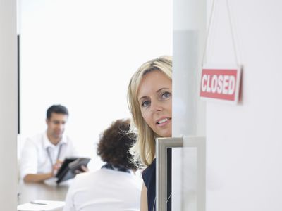 Businesswoman closing door to private office meeting