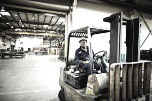 man operating a forklift inside of a warehouse