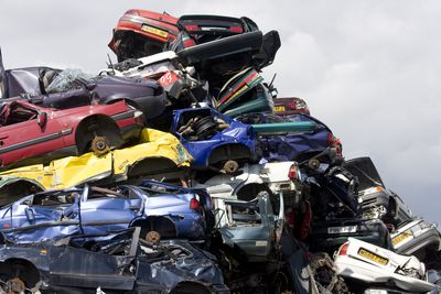 Pile of scrap cars prior to being recycled. England, UK July 2009