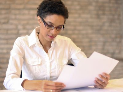 woman sorting through resumes and applications