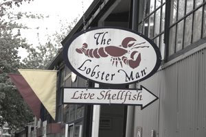 Sign on the side of a restaurant called The Lobster Man