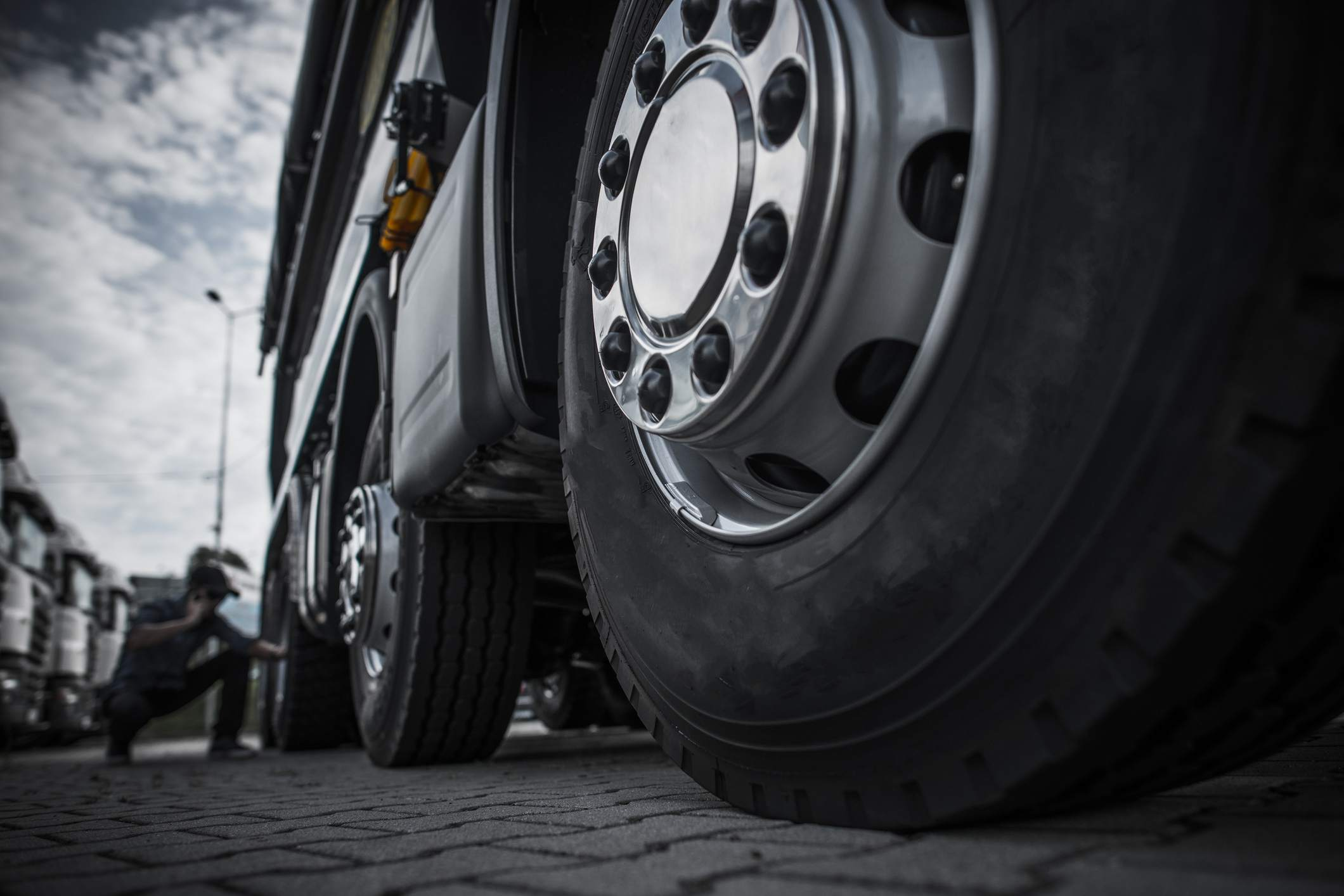 close-up of tires on commercial vehicle being inspected