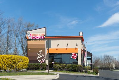 Dunkin' Donuts sign. Dunkin' Donuts is an American global doughnut company and coffeehouse chain.