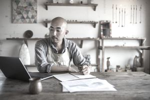 Small business owner calculating finances