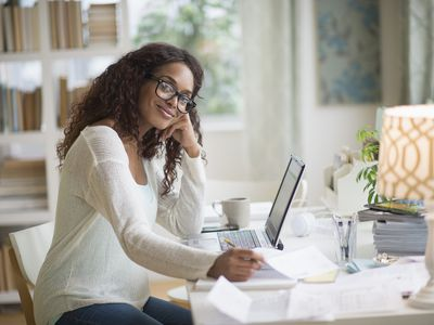 Woman using a laptop in a home office