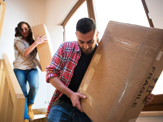 People moving fragile boxes during a move