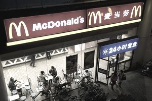 Clients exist a McDonald's fast food restaurant at night in Shanghai, China, on February 18, 2011.