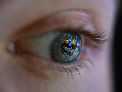 Close up of the Google logo reflected in a woman's eye
