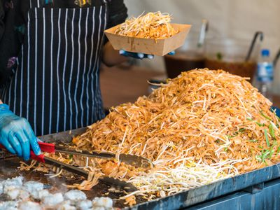 pad thai being served at a food festival