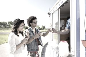 Two Friends Buying Ice Cream from a Truck