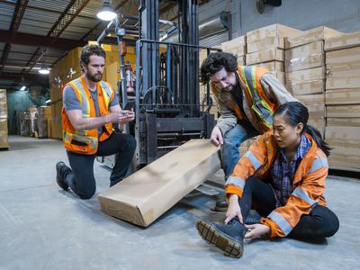 A worker injured falling or being struck by a forklift. Falls and collisions are major contributors to forklift safety.