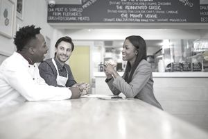 Financial planner talking with small business owners