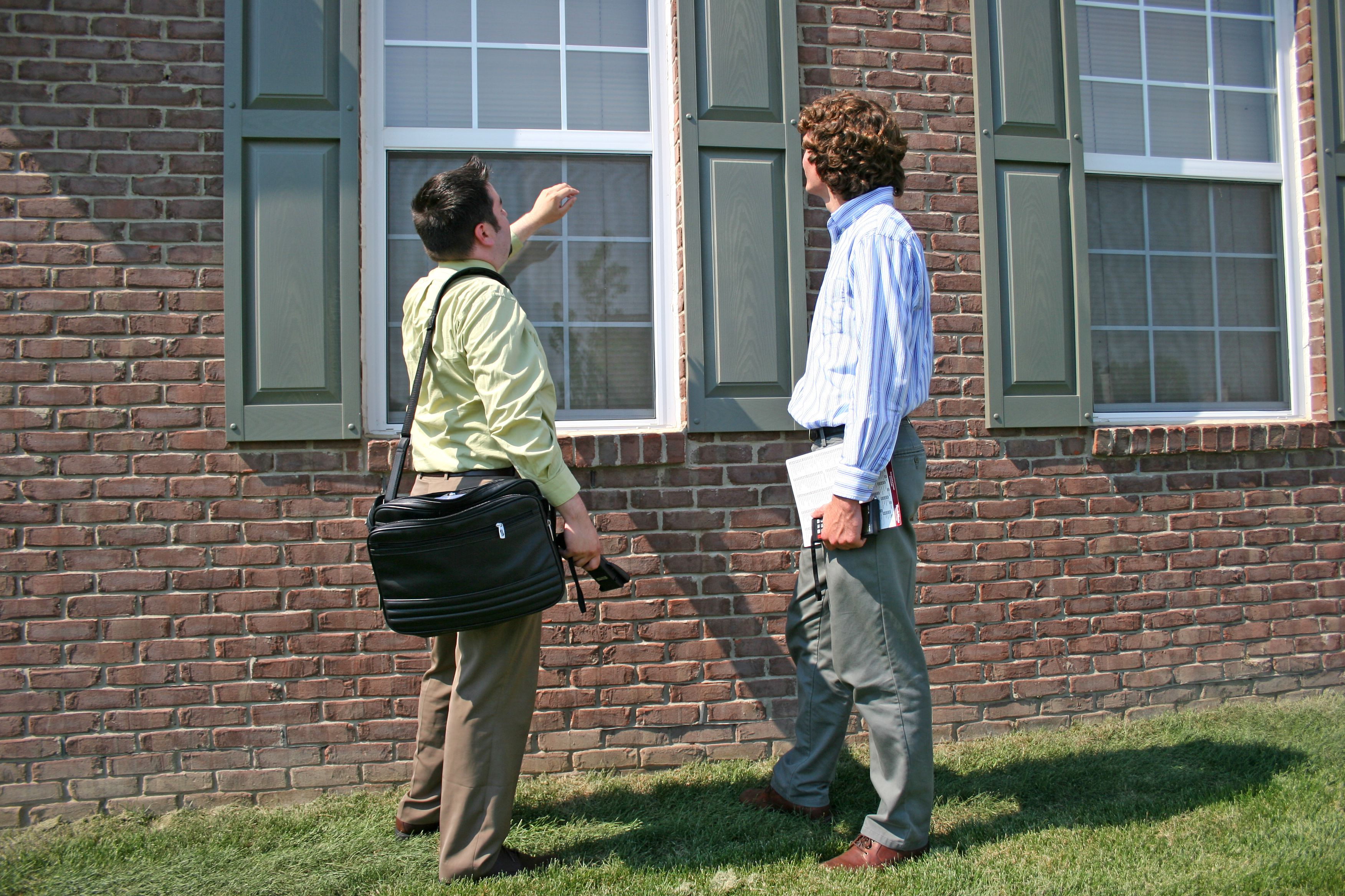 Property appraiser on outside of house.