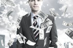 Businessman in suit with dollars raining down from crowdfunding