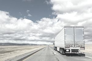 A driver-for-hire, over-the-road, semi-truck driver on Interstate 80 in Wyoming