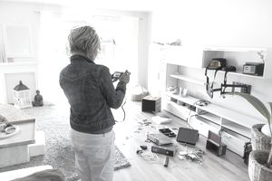 Landlord taking photos of damaged property in a tenant's unit after an eviction.