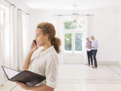 Real estate agent on cell phone