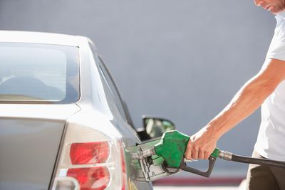 Man filling car with gas