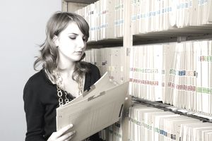 Young woman working in a file room