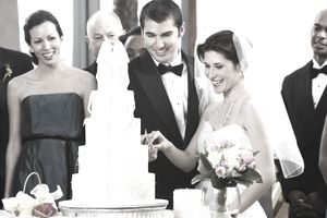 Newlyweds Cutting the Cake at traditional wedding