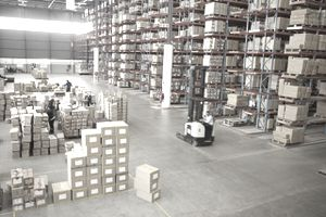 Elevated view of large distribution warehouse similar to Amazon, with pick to light systems