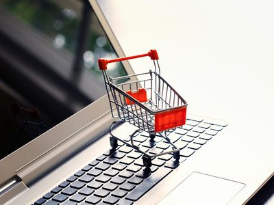 Tiny shopping cart on a laptop computer representing the eBay shopping cart.