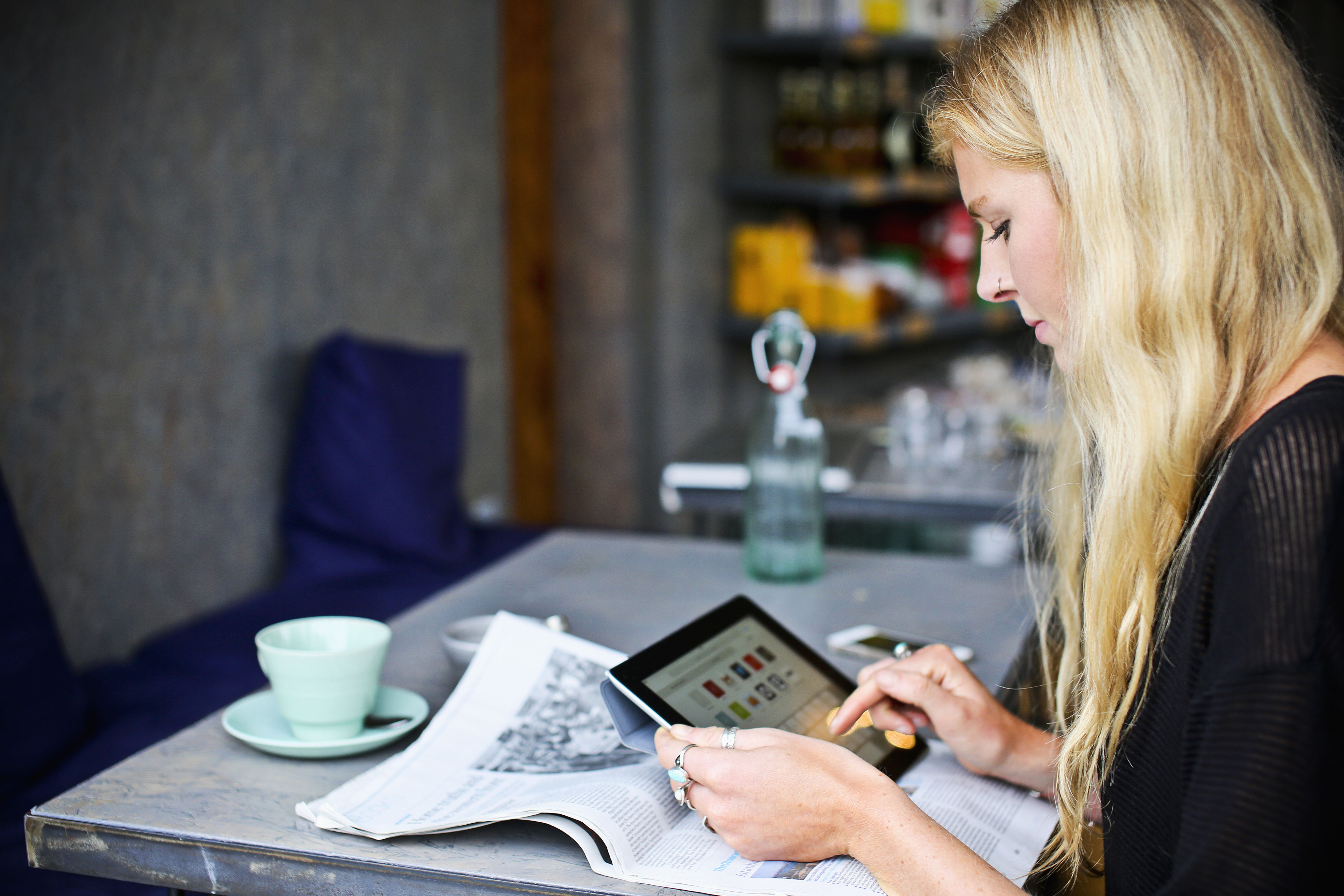 Woman Using a Tablet Computer in a Cafe