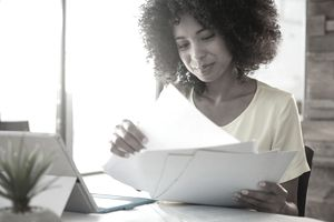 young businesswoman looking at paperwork