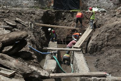Construction Workers Working At Site