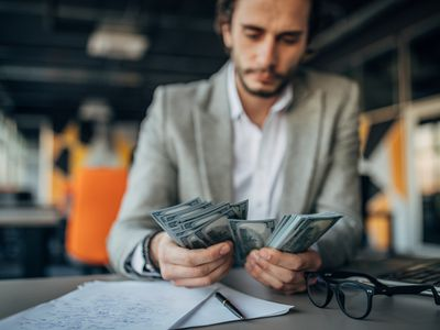 Businessman counting money in an office
