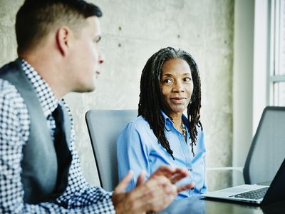 Businessperson working with consultant in office