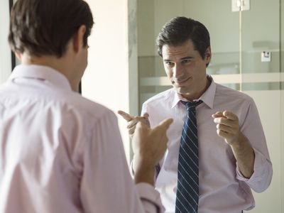 Man smiling at his reflection in mirror