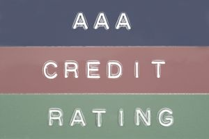 """Blue, red and green sign with words """"AAA Credit Rating"""""""