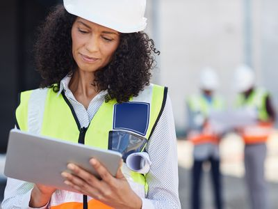 Female building engineer using a tablet on her work site