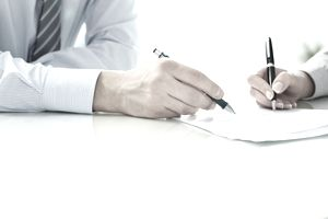 Accepting a contractor's bid by signing on the dotted line.