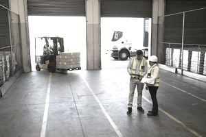 Workers inside a exporting food distribution warehouse