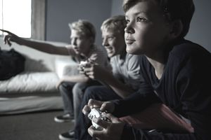 Kids playing video games in front of the television