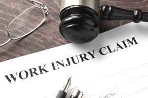 Worker compensation. Work injury claim on a table.