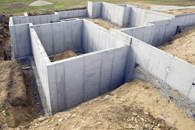 Foundation walls on a job site that begins the process of constructing a solid and safe structure.