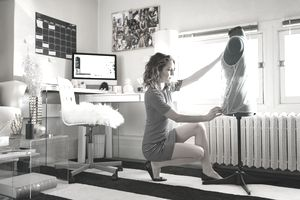 Young woman fashion designer working in home studio