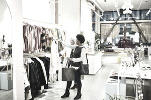 Two women shopping in upscale clothing boutique