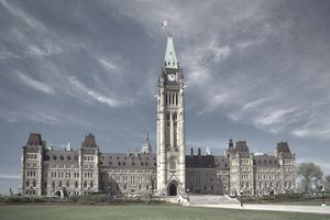 Canadian parliament buildings against a brilliant sky with wispy clouds.