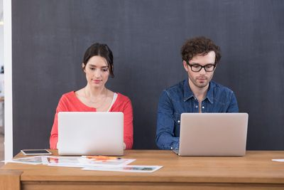 Two people with computers