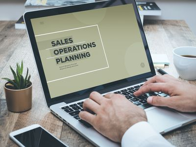 Businessperson creating a Sales and Operations Planning PowerPoint