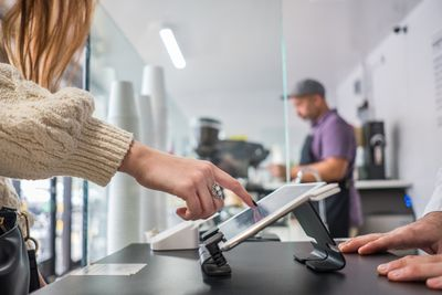 Customer using POS system to place order