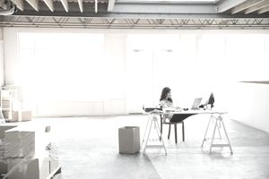 Business woman in a minimal office space