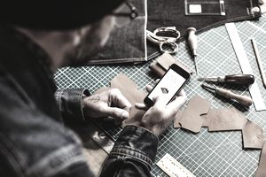 A craftsman checks his mobile website